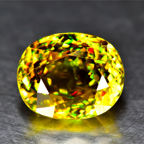 11.58CT CUSTOM OVAL CUT RED FLASH UNHEATED MULTI-COLOR TITANITE SPHENE GEMSTONE