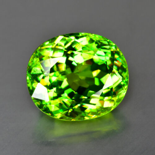 5.02CT MASTER OVAL CUT FINE CLARITY UNHEATED RED FLASH GREEN TITANITE SPHENE