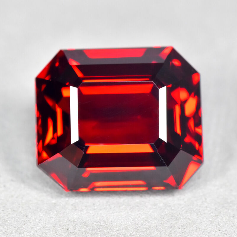 6.37Ct Emerald Cut, Impressive VVS_Clarity Unheated Coke Red Spessartite Garnet