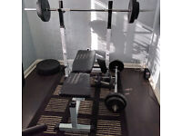 Weight set. Including bench, barbell, dumbells and EZ bar.