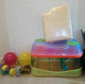 2 tier hamster cage with tunnel, seesaw, 2 balls with stands, food bowl, bottle, house and sawdust