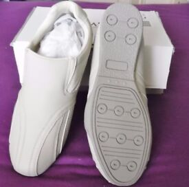 MENS SLIP ON TRAINERS. SIZE.11 NEW AND BOXED.