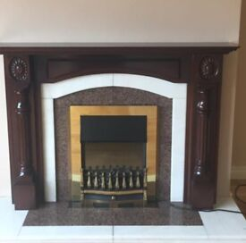 Lovely marble & mahogany fireplace with electric fire