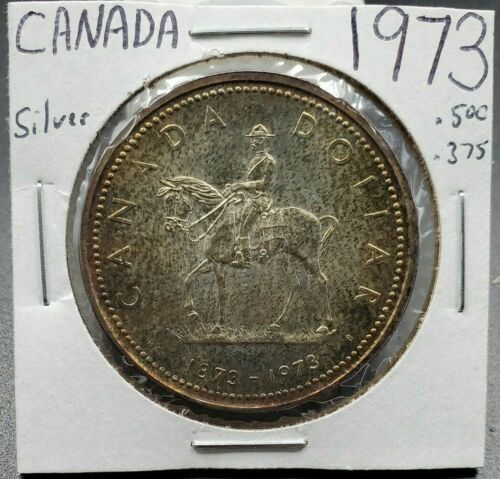 1973 $1 Canada Silver Dollar Coin Gem BU UNC Neat Toning Combined Ship Discounts
