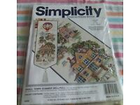 New counted cross stitch bell pull called Small Town in Summer.