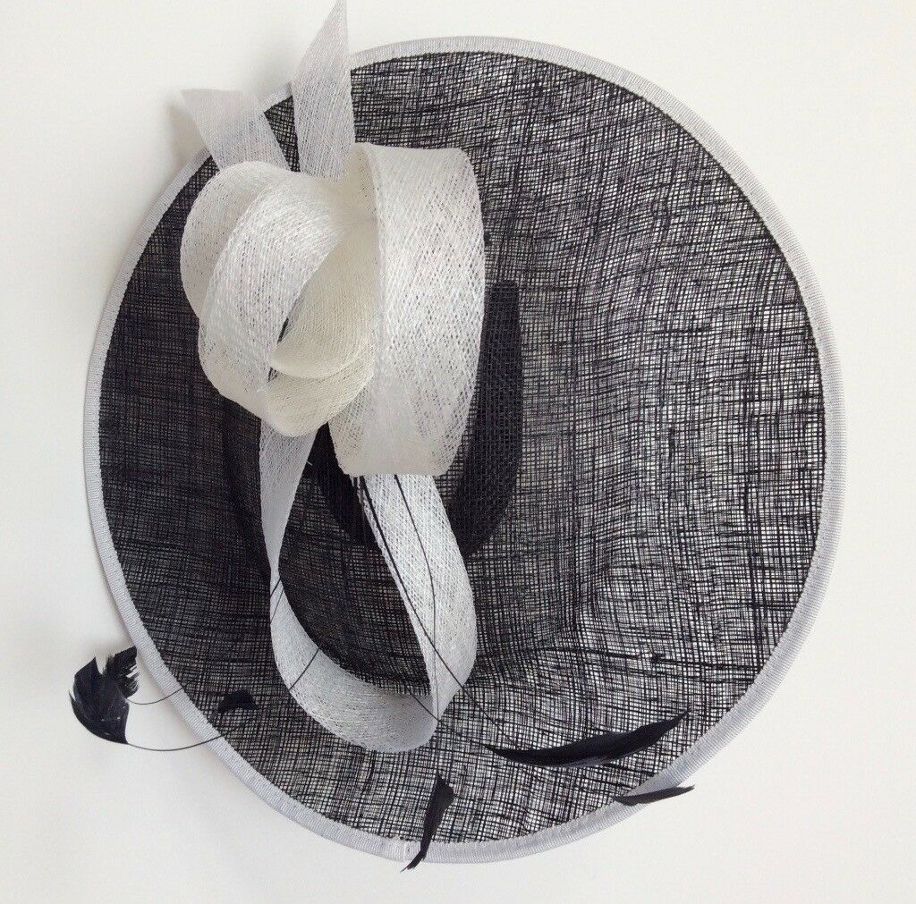 Ladies formal wedding hat by Debut-Navy two tone saucer with feather  fascinator 372ee8784dc