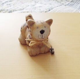 Cat Ornament. Pottery with metal bells, 4 inches high by 4 inches wide.