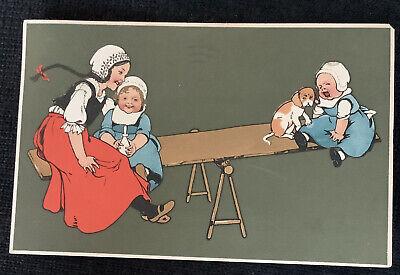 vintage Postcard a Children on seesaw puppy dog 1913