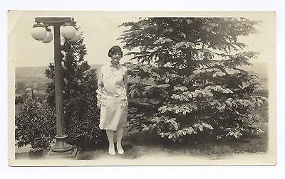 Snapshot  Woman Stands Next To Cast Iron Street Light  Glass Globes  1920S 30S