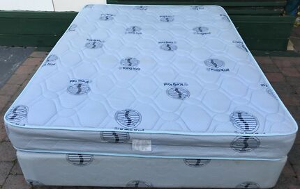 Good condition King Koil Brand Queen Bed set. Delivery available