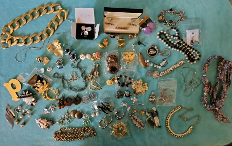 Lot Of 64  Pieces of costume jewelry some signed name brand