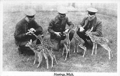 Milk Man Uniform (Hastings MI Three Men in Uniform Give Bottled Milk to Five Fawn~RPPC)