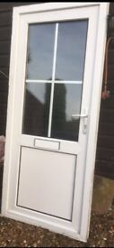 UPVC WHiTE DOUBLE GLAZED FRONT DOOR. IN FRAME READY TO FIT