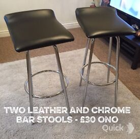 2 black leather and chrome bar stools