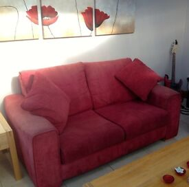Sofa's: 2 number matching stylish sofa's in red with matching cushions.
