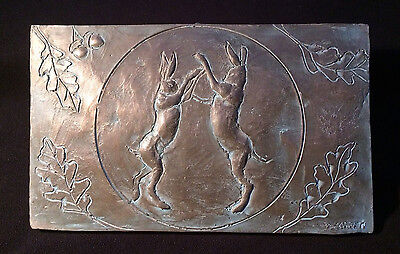 Boxing hares in the moonlight wall sculpture, cold cast bronze hare plaque
