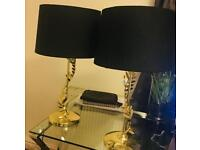 2xblack and gold bedside lamps