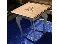 Beautiful occasional table with inlaid decoration. 1922