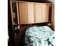 Beautiful Maple/light wood over-bed cupboards with kingsize bed frame