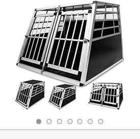 Large aluminium dog crate with sides.