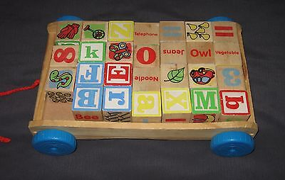 DEVELOPMENTAL CHILD TOY - PULL ALONG WOODEN WAGON WITH 27 ABC / 123 BLOCKS