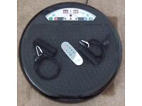 Vibrapower Disc 2 with resistance bands, remote control and instruction manual.
