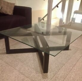Glass top coffee table - dark wood base