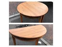 Unusual dining table can be used as full or 2 separate half circle tables