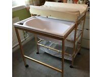 baby changing station with storage and bath