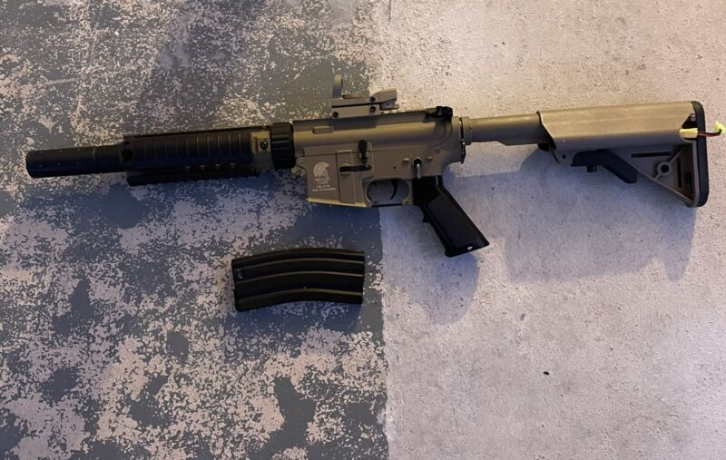 Matrix M4-airsoft Rifle with High Cap Mag and sight.