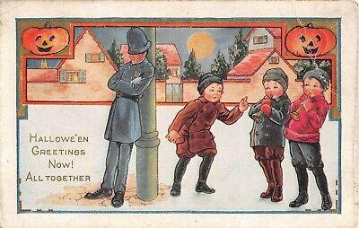 Policeman With Boys (1920 Boys with Party Horns Policeman Jack O' Lanterns Halloween postcard)