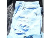 ladies light blue ripped shorts from Primark size 8 excellect condition