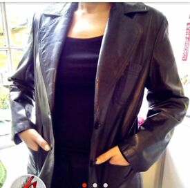 Leather jacket size 14. Pre-owned in excellent condition.Black