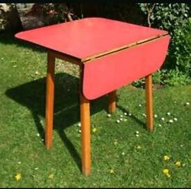 Vintage red formica topped drop leaf table