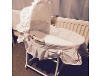White wicker rocking Moses basket from mothercare