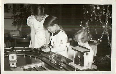 Christmas Morning Kids Toy Train Set Brother & Sister Real Photo Postcard 1937