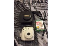 Polaroid camera with film and accessories
