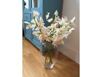 Beautiful orchid flowers with vase