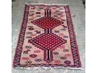 A VINTAGE HAND KNOTTED, BOKHARA THICK PILE WOOL RUG