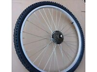 A set/pair of Bicycle wheels, brand new rear, used front. Shimano Mountain Bike