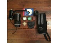Mixed camera bundle including a Sunagor 500mm f8 lens, filters, bags and Nikon DX 55-200mm (broken)