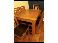 Calais extending dining table & solid wood and leather chairs
