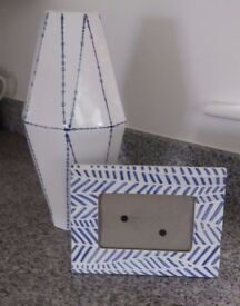 WHITE AND BLUE VASE WITH MATCHING PICTURE FRAME