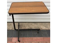 bed table or chair table rise and lowers plus it can be tilted please see all nine photos