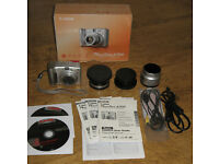 Canon Powershot A700 with lens adapter, macro lens and telephoto lens