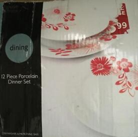 Brand new 12 piece 4 person red and white dinner set Includes plates, bowls and side plates