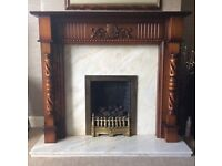 fireplace, wooden fireplace with marble hearth and living flame gas fire. £150 Ono.