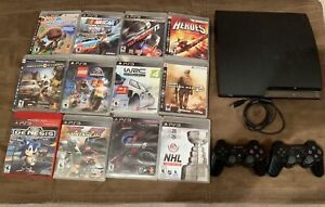 PS3 console with 2 controllers & 12 games