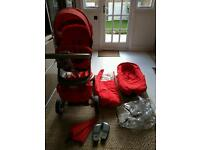 Stokke Xplory pram with chair and carrycot in red
