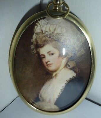 Miniature portrait of Perdita Robinson in an elaborate hat in a brass frame